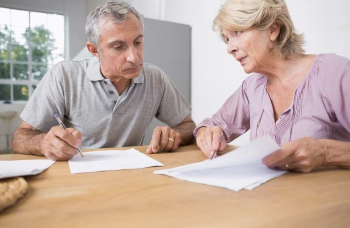 An older couple looking over their finances and estate plan